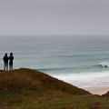 Two surfers overviewing Almagreira
